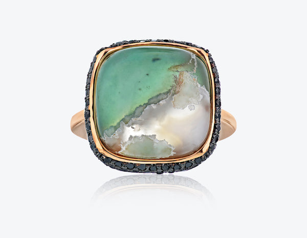 aquaprase ring set in rose gold with black diamonds