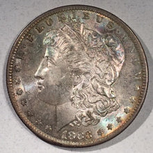 1883 O  Morgan Dollar, MS64, attractive mottled pastle rainbow toning.