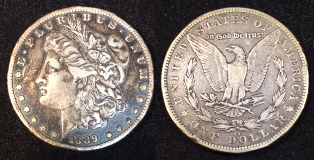 1889 CC  Morgan Dollar, VF many rim bruises and a few field ticks