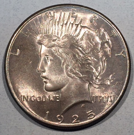 1925 Peace Dollar, Grade= MS63, attractive light peachy/purple tone.