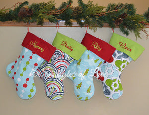 Collection of 4 personalized blue Christmas stockings
