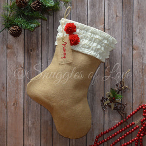 Cream ruffle personalized burlap stocking with red flower accents and monogrammed name tag