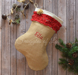Personalized tan burlap Christmas stocking with red ruffles and burlap flower