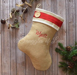 Burlap stocking with red and cream cuff and wooden button