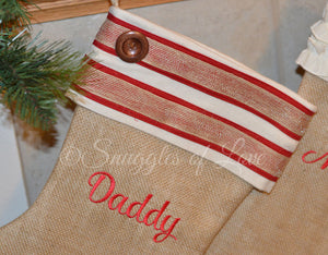 Tan burlap monogrammed Christmas stocking with red stripes and button detail