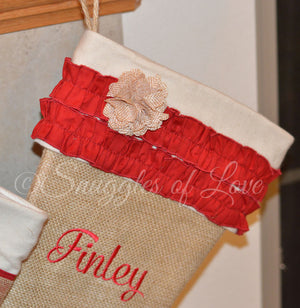 Burlap stocking with red ruffles, tan flower and monogrammed name