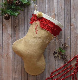 Red ruffled burlap Christmas stocking with personalized name tag
