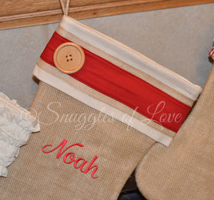 Tan burlap personalized Christmas stocking with red stripe and wood button