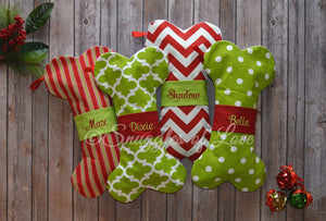 Red and green dog Christmas stockings in the shape of dog bones