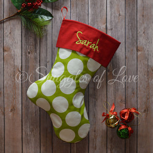 Personalized Christmas stocking with green polka dots and red cuff