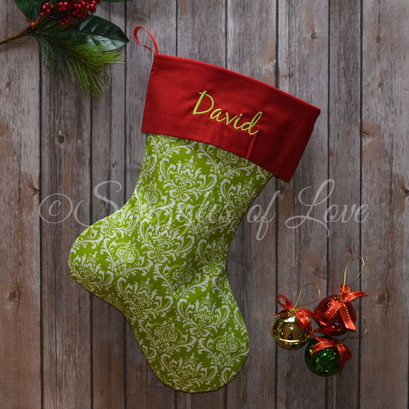 Monogrammed green damask print Christmas stocking with red cuff