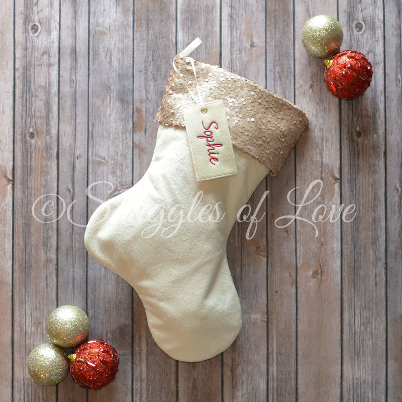 Personalized champagne sequin Christmas stocking with cream velvet and name tag