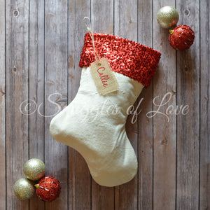 Cream velvet Christmas stocking with red sparkle sequin cuff and name tag