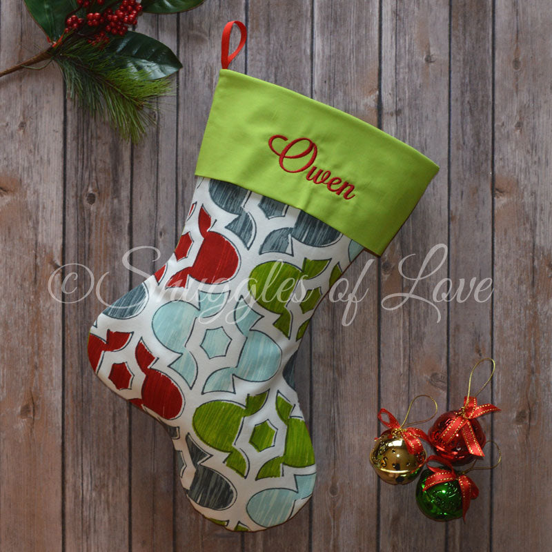 Personalized blue geometric Christmas stocking with red, green and blue colors