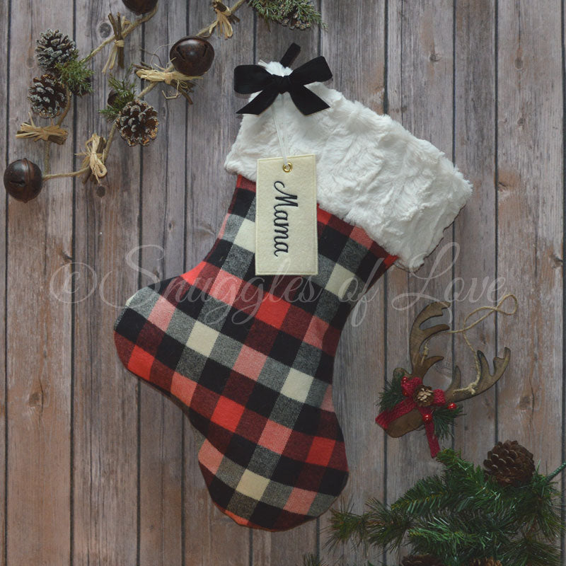 Red and black buffalo check Christmas stocking with personalized hanging name tag