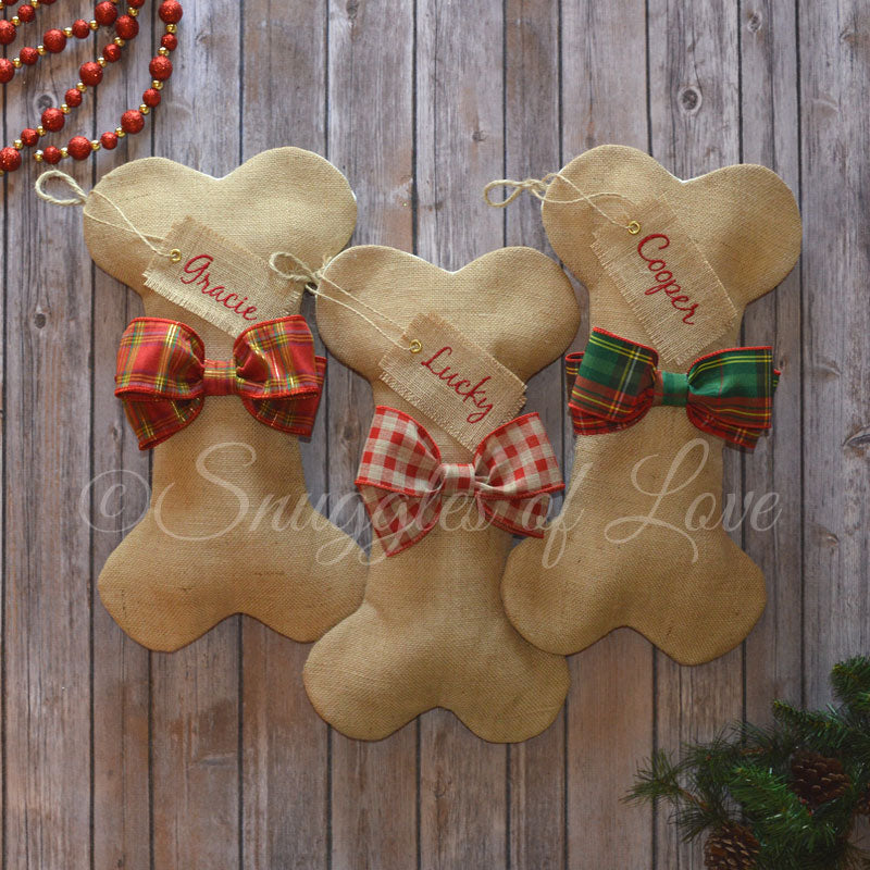 Burlap dog bone stockings with red plaid, red check and red/green plaid bows