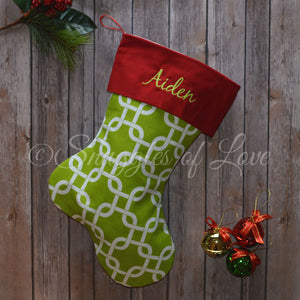 Monogrammed green geometric link patterned Christmas stocking
