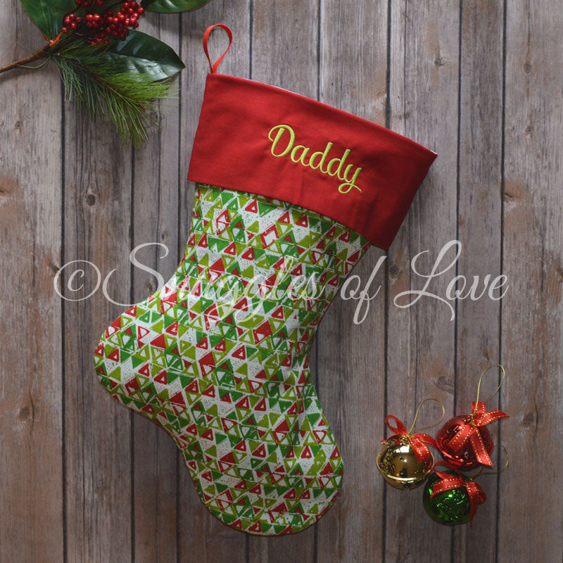 Green and red Christmas stockings with personalization and red and green cuffs