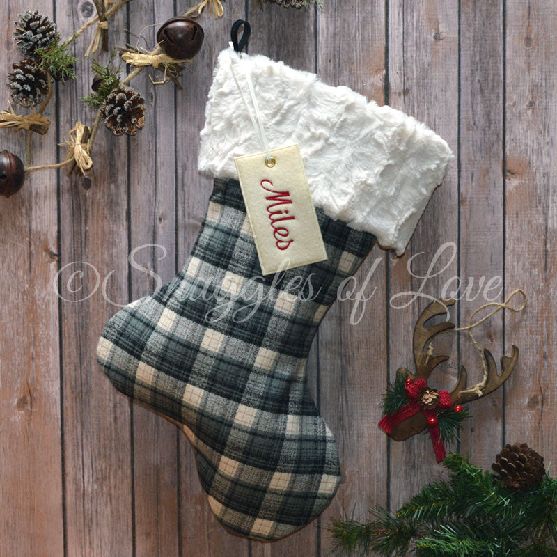Personalized black and grey plaid Christmas stocking with fur cuff and name tag
