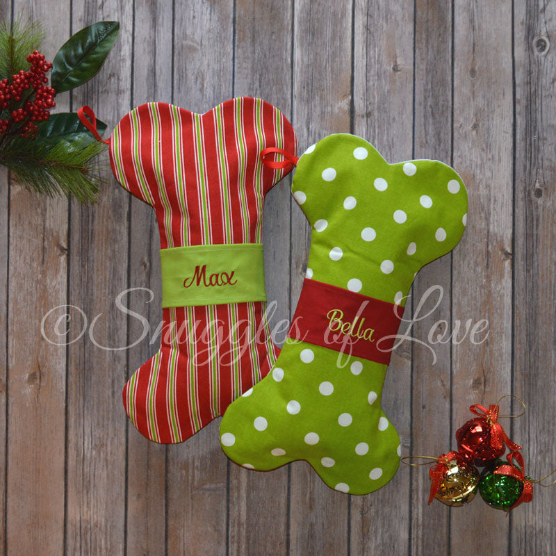 Green dog Christmas stockings with red middle band and embroidered name