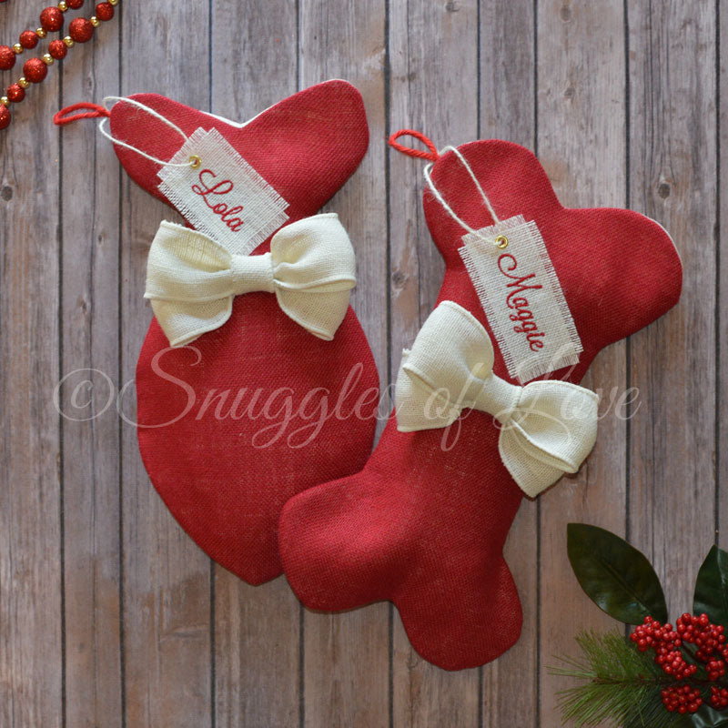Red burlap dog and cat stockings with ivory bows
