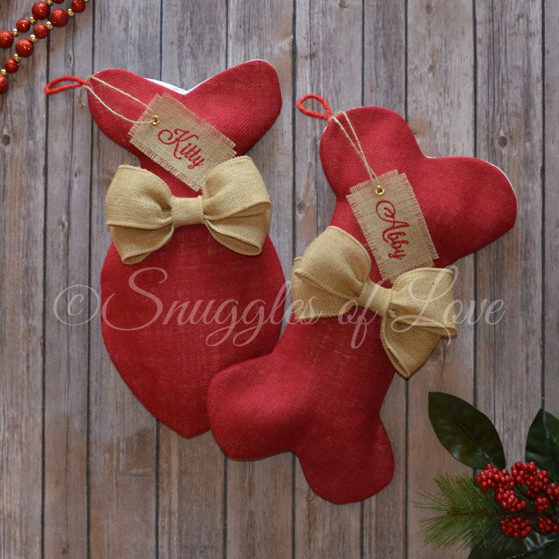 Red burlap dog and cat stockings with tan burlap bows