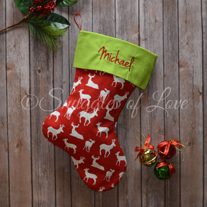 Red deer Christmas stocking with white bucks and green stocking cuff