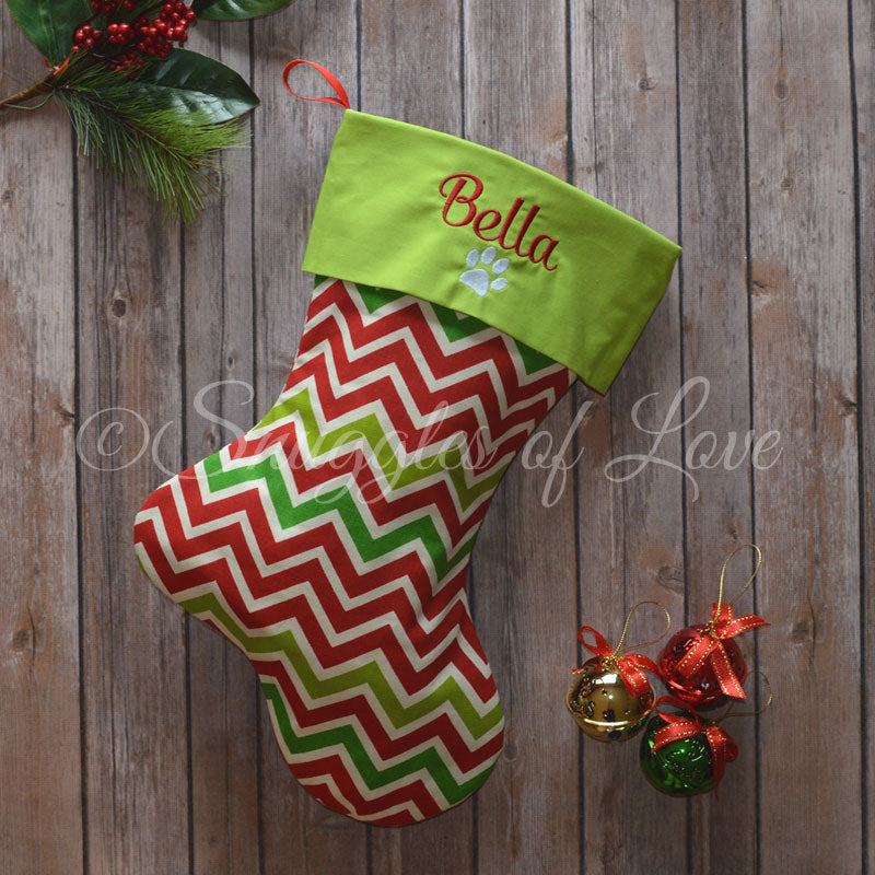 Personalized set of red and green stockings for family with matching dog stocking