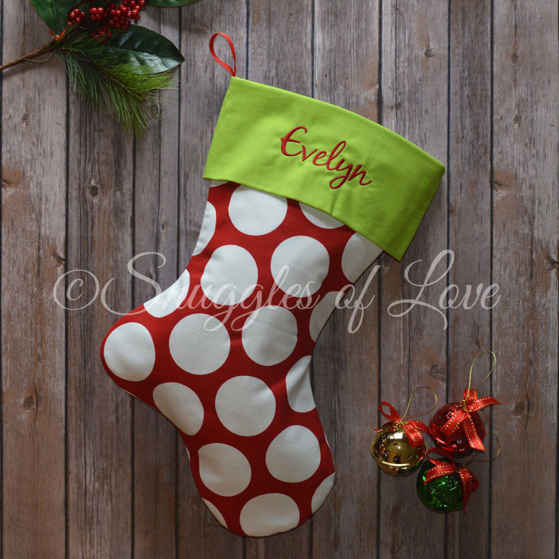 Personalized red and white polka dot Christmas stocking with green cuff