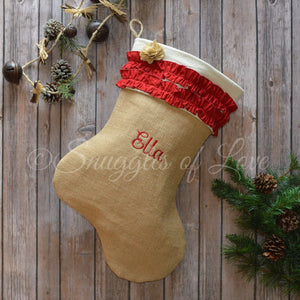 Personalized burlap Christmas stocking with red ruffles and tan burlap flower detail