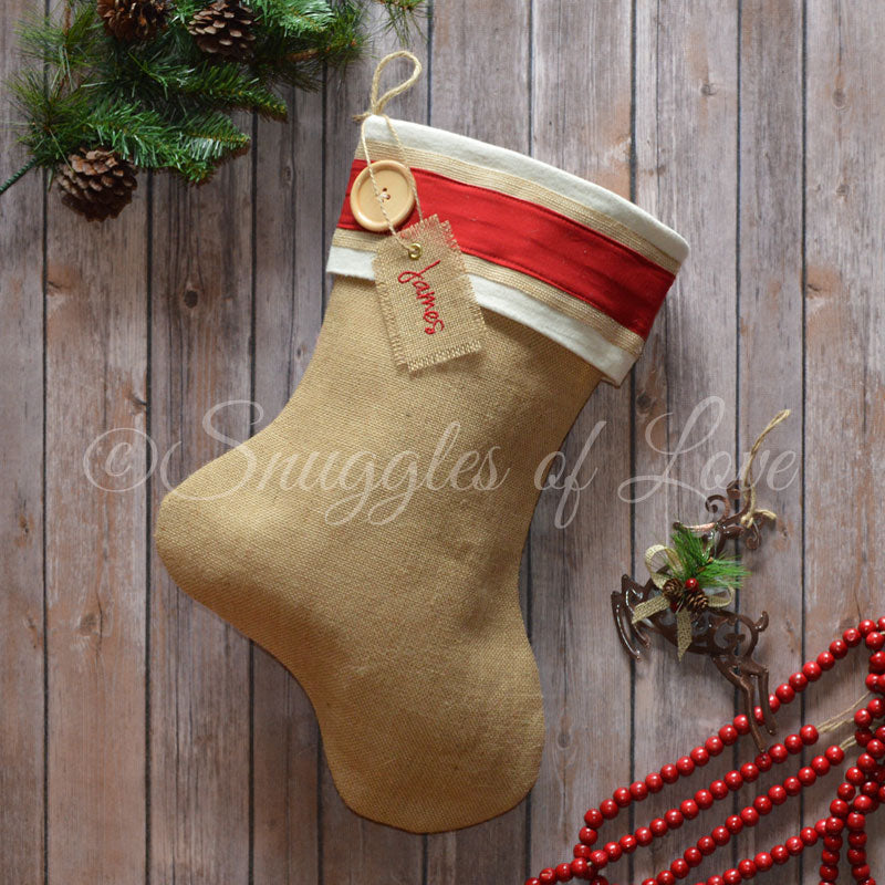 Cream and red burlap Christmas stocking with monogrammed hanging tag