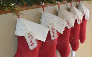 Monogrammed red burlap Christmas stockings with cream ivory cuffs