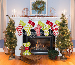 Red and green patterned Christmas stockings with personalized names