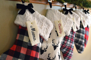 Rustic plaid Christmas stocking collection with personalized tags
