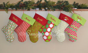 Red and green stockings with embroidered stocking cuffs