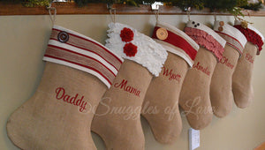 Tan burlap Christmas stockings with names embroidered on the middle