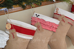 Rustic burlap Christmas stocking collection with personalized tags