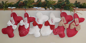 Burlap dog and cat stockings with ivory, red and tan bows