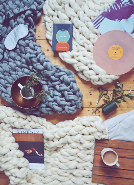 Hygge life flatlay knitted blanket