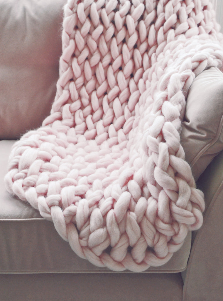 pale pink chunky knit arm knitted blanket throw