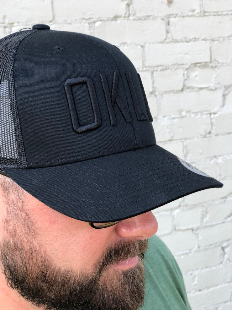OKLA Trucker Hat-Black/Black