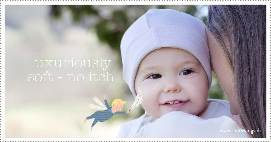 newborn baby clothing. keep baby happy in organic merino from newborn