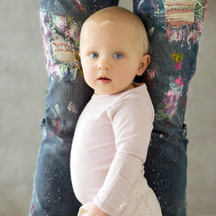 baby wearing organic merino top