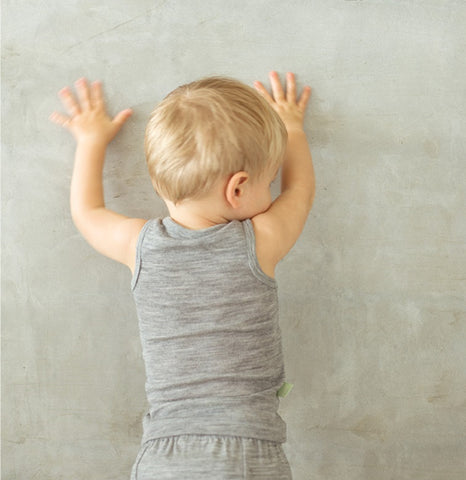 boy in grey marle top
