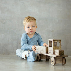 boy dressed in north sea blue organic merino rib top and leggings