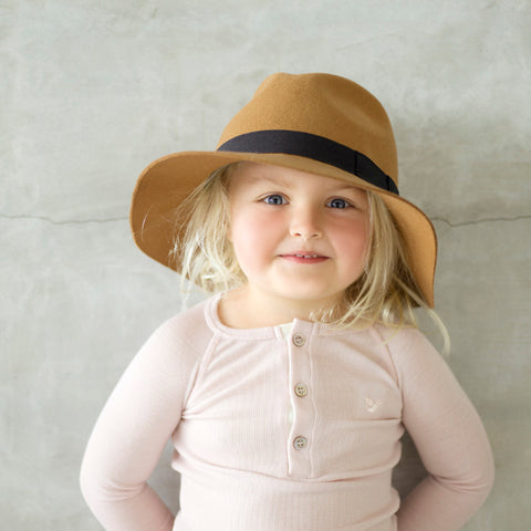 young girl wearing dusty rose organic merino top