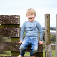 boy wearing north sea blue merino rib top
