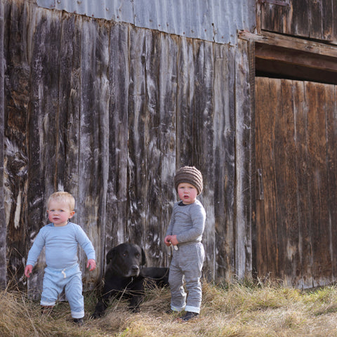 boys outside in merino clothing with dog