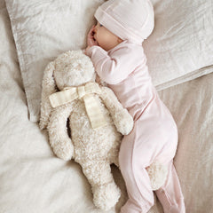 baby sleeping wearing organic merino sleepwear