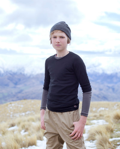 boy wearing black merino wool long sleeve top